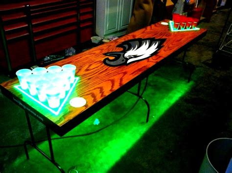 Eagles wood beer pong table with LED lights and ball